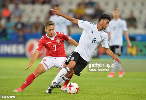 Andrew Hjulsager of Denmark puts pressure on Mahmoud Dahoud of Germany during the UEFA European Under21 Championship Group C match between Germany...