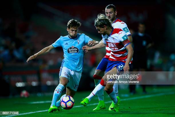 Andrew Hjulsager of RC Celta de Vigo competes for the ball with Rene Krhin of Granada CF and his teammate Gabriel Silva during the La Liga match...