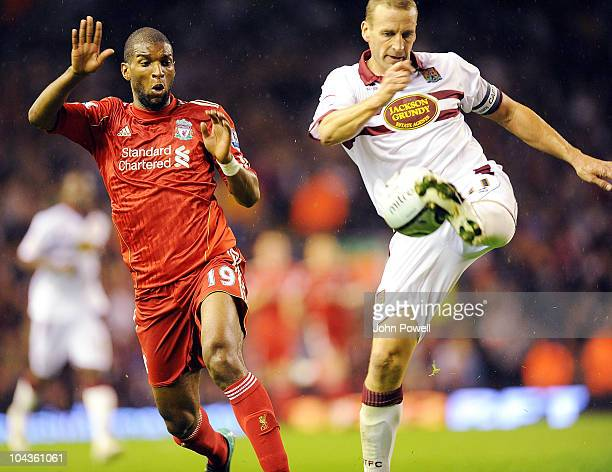 Andrew Holt of Northampton Town clears from Ryan Babel of Liverpool during the Carling Cup 3rd round game between Liverpool and Northampton Town at...