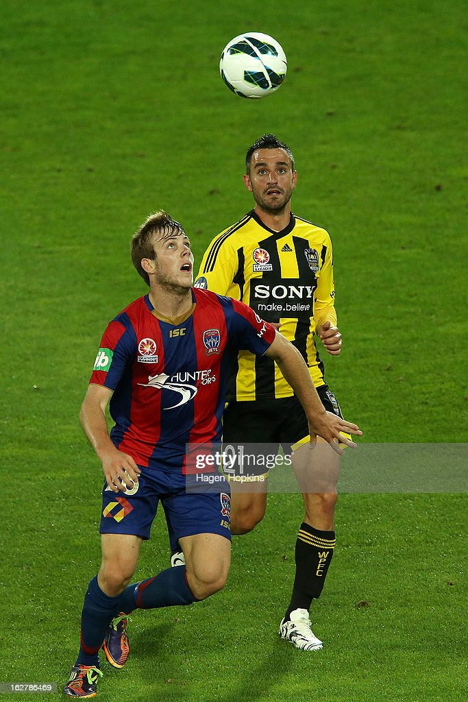 Andrew Hoole of the Jets and Dani Sanchez of the Phoenix compete for the ball during the round 26 A-League match between the Wellington Phoenix and the Newcastle Jets at Westpac Stadium on February 27, 2013 in Wellington, New Zealand.