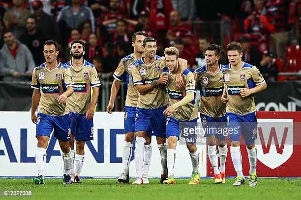 Andrew Hoole of the Jets celebrates with team mates after scoring the final goal during the round three ALeague match between the Western Sydney...