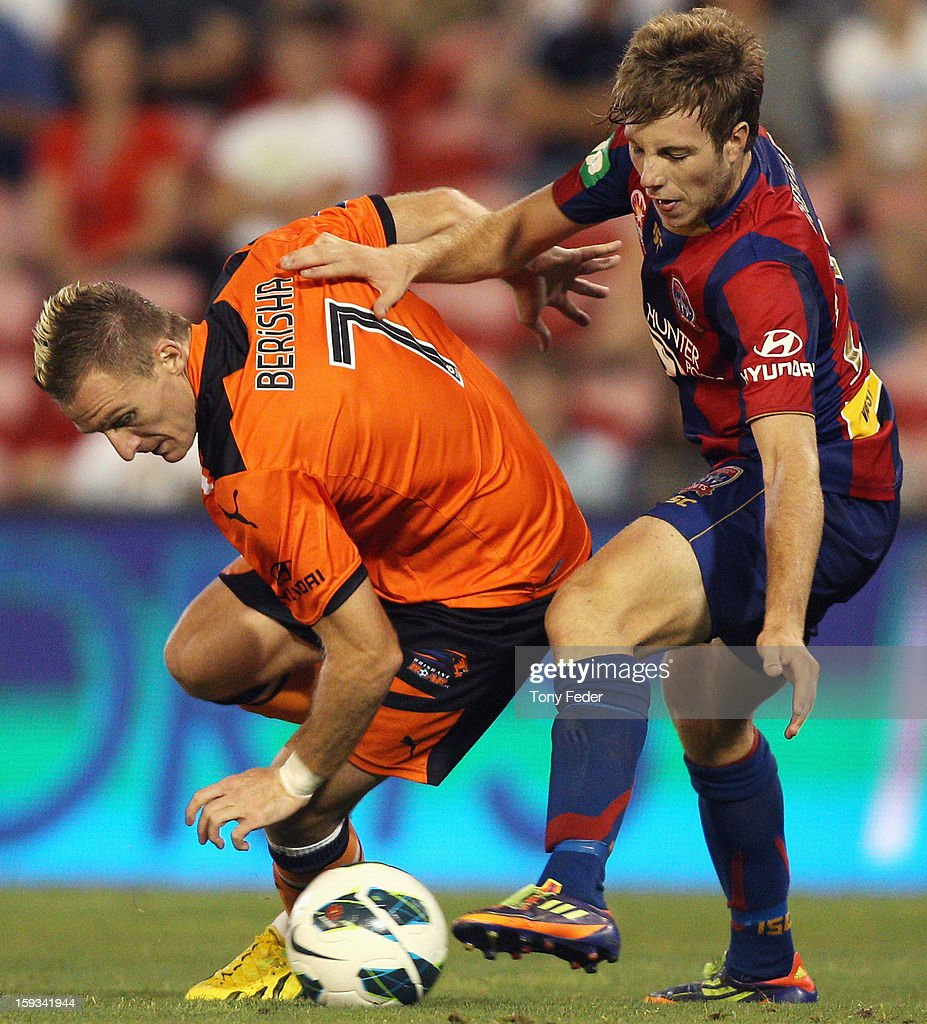 Andrew Hoole of the Jets contests the ball with Besart Berisha of the Roar during the round 16 A-League match between the Newcastle Jets and the Brisbane Roar at Hunter Stadium on January 12, 2013 in Newcastle, Australia.