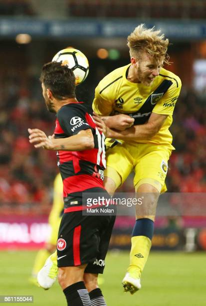 Andrew Hoole of the Mariners and Alvaro Cejudo of the Wanderers collide during the round two ALeague match between the Western Sydney Wanderers and...
