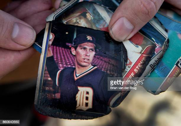 Andrew Hopkins sifts through his father's firesinged baseball card collection at his stepmother Pam Hopkins' home in the Coffey Park neighborhood on...