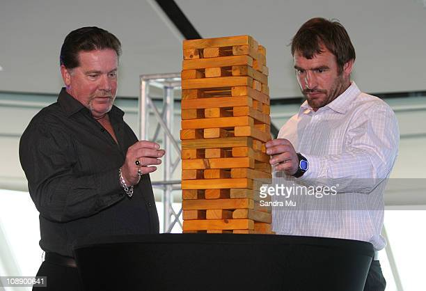 Andrew Hore of the Hurricanes plays jenga with Super Fan Craig Stewart in a Super Rugby captain's challenge during the 2011 Super Rugby Season Launch...
