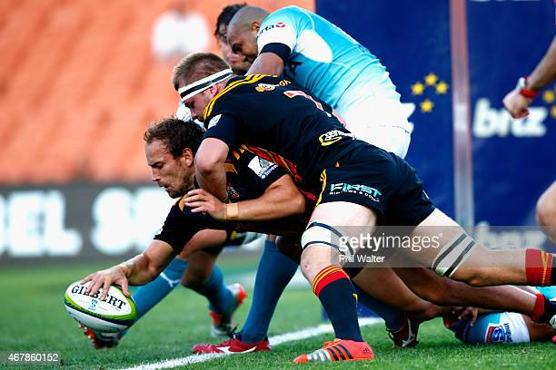Andrew Horrell of the Chiefs scores a try during the round seven Super Rugby match between the Chiefs and the Cheetahs at Waikato Stadium on March 28...