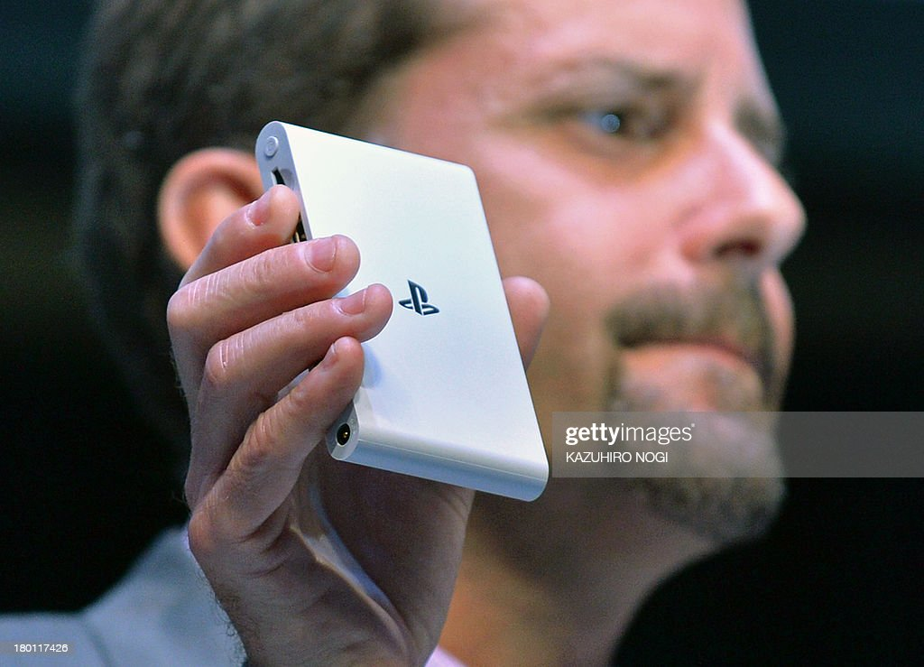 Andrew House, President and Group CEO of Sony Computer Entertainment Inc., displays the company's PlayStation Vita TV during the SCEJA press conference in Tokyo on September 9, 2013. Sony said it will start selling its PlayStation 4 on February 22, 2014 in Japan, with a price tag of 420 USD (41,979 yen).