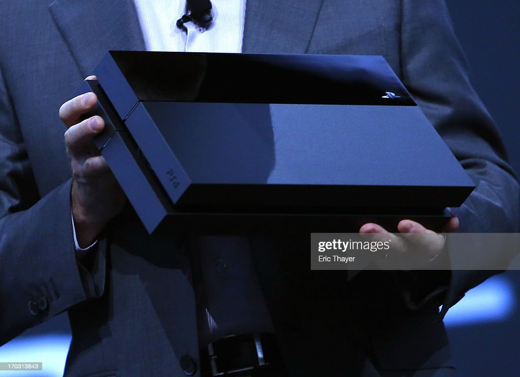 Andrew House, President and Group CEO Sony Computer Entertainment Inc., holds up a Playstation 4 at the Sony Playstation E3 2013 press conference June 10, 2013 in Los Angeles, California. Thousands are expected to attend the annual three-day convention to see the latest games and announcements from the gaming industry.