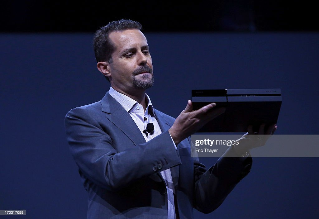 Andrew House, president and group CEO Sony Computer Entertainment Inc., holds up a Playstation 4 at the Sony Playstation E3 2013 press conference on June 10, 2013 in Los Angeles, California. Thousands are expected to attend the annual three-day convention to see the latest games and announcements from the gaming industry.