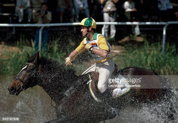 Andrew Hoy of Australia riding Kiwi during the crosscountry section of the threeday eventing competition at the Summer Olympic Games in Seoul South...
