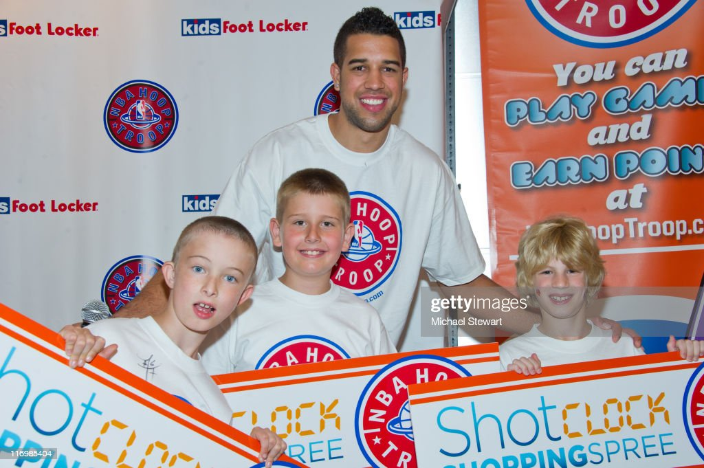 Andrew, Ian, NBA player <a gi-track='captionPersonalityLinkClicked' href=/galleries/search?phrase=Landry+Fields&family=editorial&specificpeople=4184645 ng-click='$event.stopPropagation()'>Landry Fields</a> and Jake attend the Shot Clock shopping spree at Kids Foot Locker, Herald Square on June 18, 2011 in New York City.