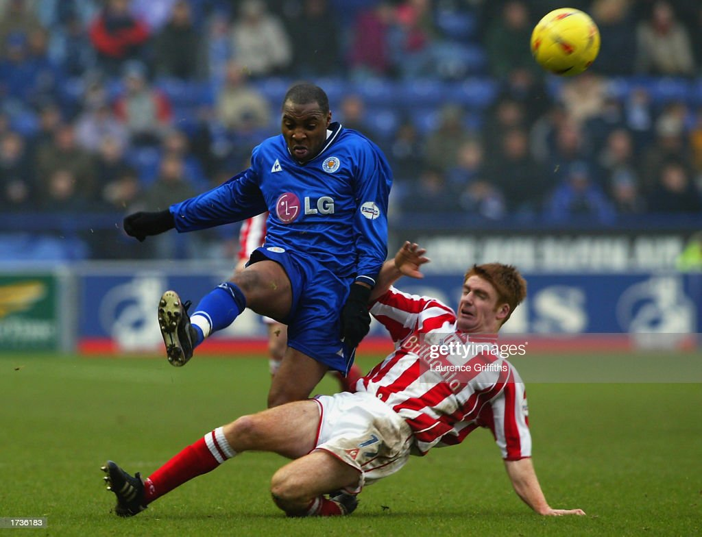 Andrew Impey of Leicester City clears the ball as James O'Connor of Stoke City comes sliding in to make a challenge during the Nationwide League Division One match held on January 11, 2003 at the Walkers Stadium, in Leicester, England. The match ended in a 0-0 draw.