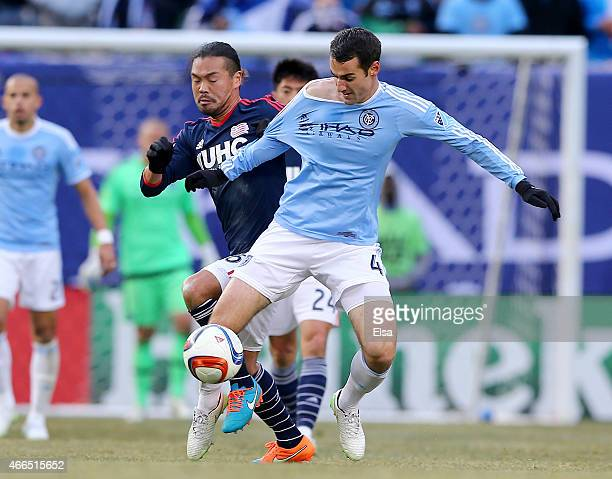Andrew Jacobson of New York City FC and Daigo Kobayashi of New England Revolution fight for the ball during the inaugural game of the New York City...