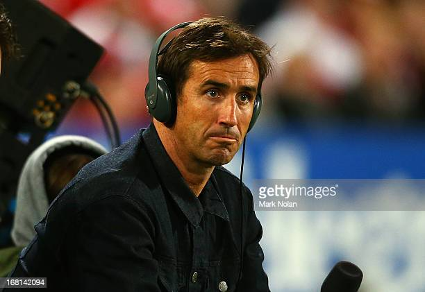 Andrew Johns commentates from the sideline for Triple M Radio during the round eight NRL match between the St George Illawarra Dragons and the Manly...