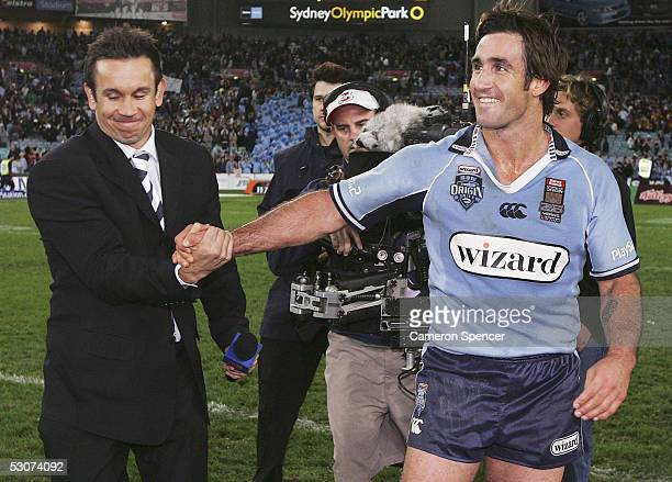 Andrew Johns of the Blues is congratulated by his brother commentator Matthew Johns after winning match two of the ARL State of Origin series between...