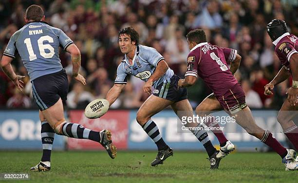 Andrew Johns of the Blues offloads the ball during game three of the ARL State of Origin series between the Queensland Maroons and the New South...