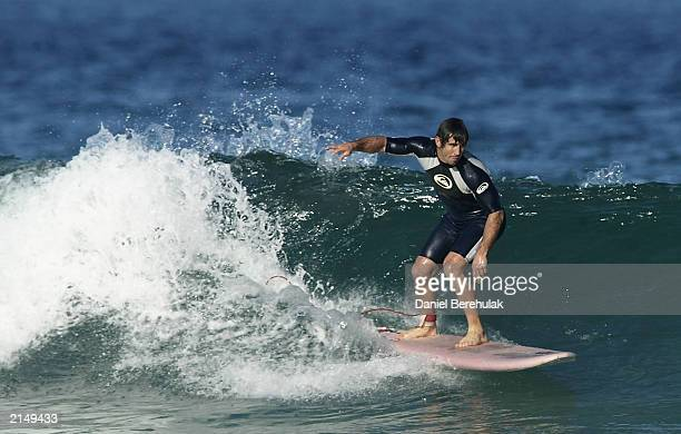 Andrew Johns of the Blues surfs during the New South Wales Blues State of Origin 3 preparation at Bluey's Beach on July 10 2003 in Forster Australia