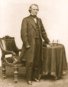Andrew Johnson fulllength portrait standing facing right with table and chair