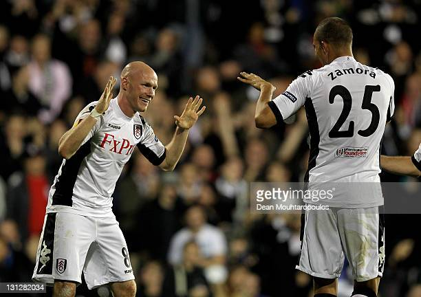 Andrew Johnson of Fulham celebrates with teammate Bobby Zamora after scoring his team's third goal during the UEFA Europa League group K match...