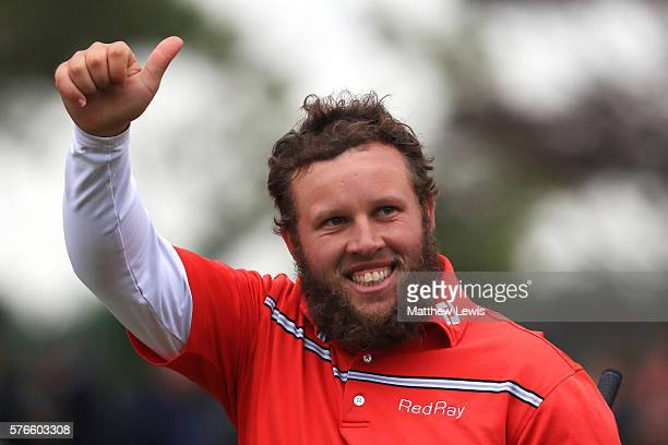 Andrew Johnston of England acknowledges the crowd after his round on 18th green during the third round on day three of the 145th Open Championship at...