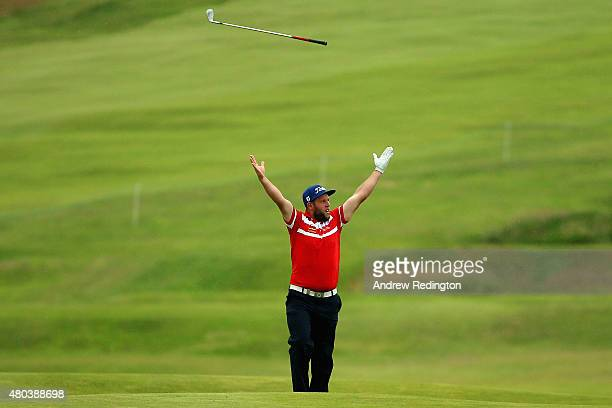 Andrew Johnston of England celebrates after holing his second shot to make an eagle on the 18th hole during the third round of the Aberdeen Asset...