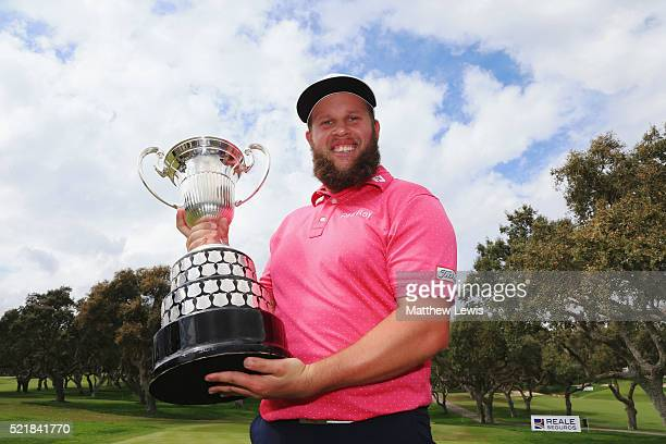 Andrew Johnston of England celebrates with the trophy after victory during the final round on day four of the Open de Espana at Real Club Valderrama...