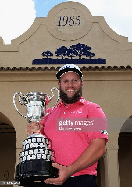 Andrew Johnston of England celebrates with the trophy after victory during the final round of the Open de Espana at Real Club Valderrama on April 17...