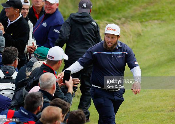 Andrew Johnston of England 'high fives' spectators on the 5th hole during the final round on day four of the 145th Open Championship at Royal Troon...