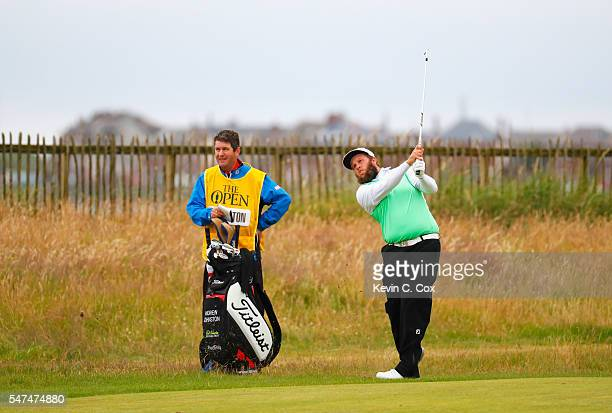 Andrew Johnston of England hits a shot next to his caddie Gordon Faulkner on the 1st during the second round on day two of the 145th Open...
