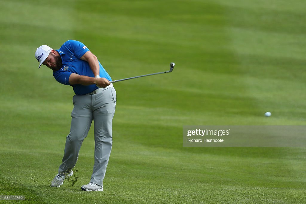 <a gi-track='captionPersonalityLinkClicked' href=/galleries/search?phrase=Andrew+Johnston+-+Golfer&family=editorial&specificpeople=15823456 ng-click='$event.stopPropagation()'>Andrew Johnston</a> of England hits his 2nd shot on the 4th hole during day one of the BMW PGA Championship at Wentworth on May 26, 2016 in Virginia Water, England.