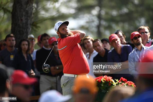 Andrew Johnston of England hits his tee shot on the fourth hole during the second round of the Omega European Masters at CranssurSierre Golf Club on...