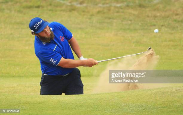 Andrew Johnston of England hits his third shot from the bunker on the 18th hole during the final round of the 146th Open Championship at Royal...