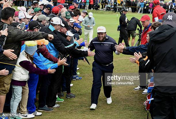 Andrew Johnston of England is encouraged by the crowd during the final round on day four of the 145th Open Championship at Royal Troon on July 17...