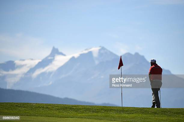 Andrew Johnston of England looks on on whilst waiting to putt on the seventh green during the second round of the Omega European Masters at...