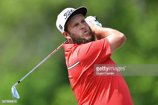 Andrew Johnston of England plays an Iron shot on the fourth hole during the third round on day three of The Nordea Masters at Bro Hof Slott Golf Club...
