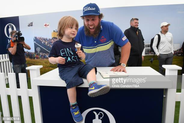 Andrew Johnston of England poses with a young fan in the autograph zone during the first round of the 146th Open Championship at Royal Birkdale on...