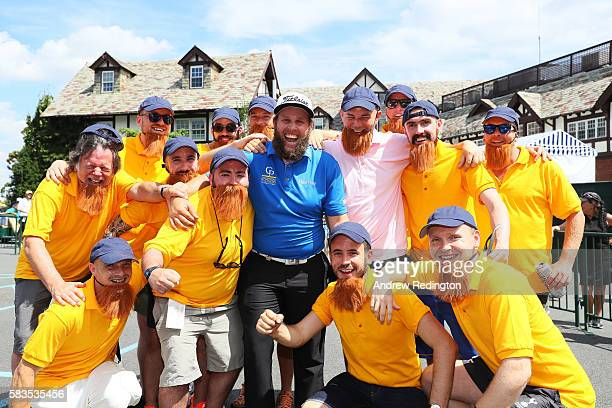 Andrew Johnston of England poses with English golf fans who are celebrating a bachelor party during a practice round prior to the 2016 PGA...