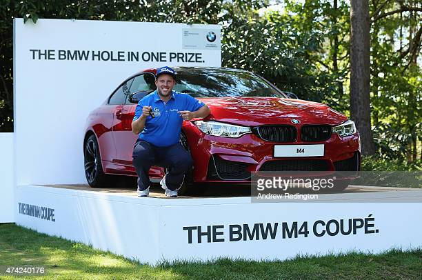 Andrew Johnston of England poses with the keys to his new BMW M4 Coupe after his holeinone on the 10th hole during day 1 of the BMW PGA Championship...