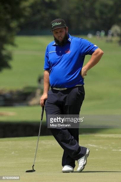 Andrew Johnston of England prepares to putt on the seventh green during the first round of the 2017 PGA Championship at Quail Hollow Club on August...