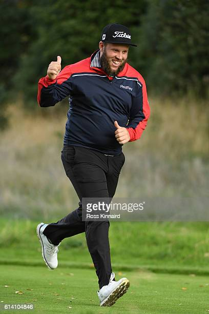 Andrew Johnston of England runs down the second fairway during the Hero ProAm at The Grove on October 12 2016 in Watford England
