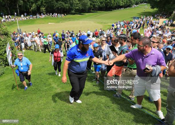 Andrew Johnston of England shakes hands with spectators on the 3rd hole during the final round on day four of the BMW PGA Championship at Wentworth...