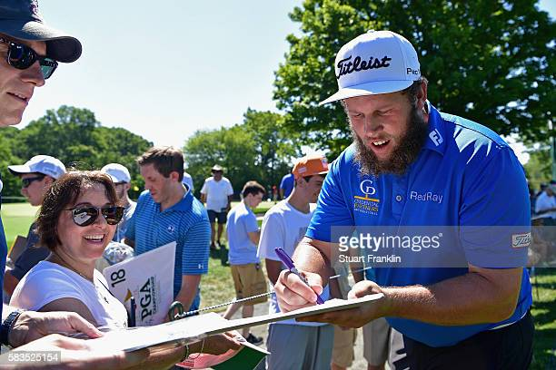 Andrew Johnston of England signs autographs during a practice round prior to the 2016 PGA Championship at Baltusrol Golf Club on July 26 2016 in...