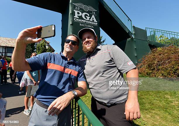 Andrew Johnston of England takes a photo with a fan during a practice round prior to the 2016 PGA Championship at Baltusrol Golf Club on July 27 2016...