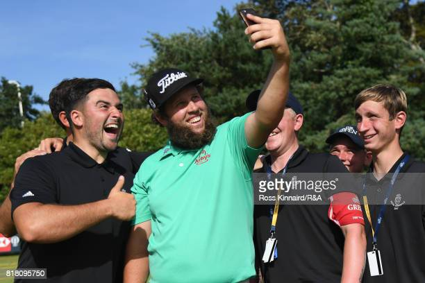 Andrew Johnston of England takes a selfie for fans during a practice round prior to the 146th Open Championship at Royal Birkdale on July 18 2017 in...