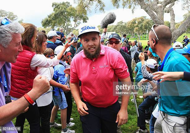 Andrew Johnston of England walks past spectators on the 18th green after his round during the final round on day four of the Open de Espana at Real...
