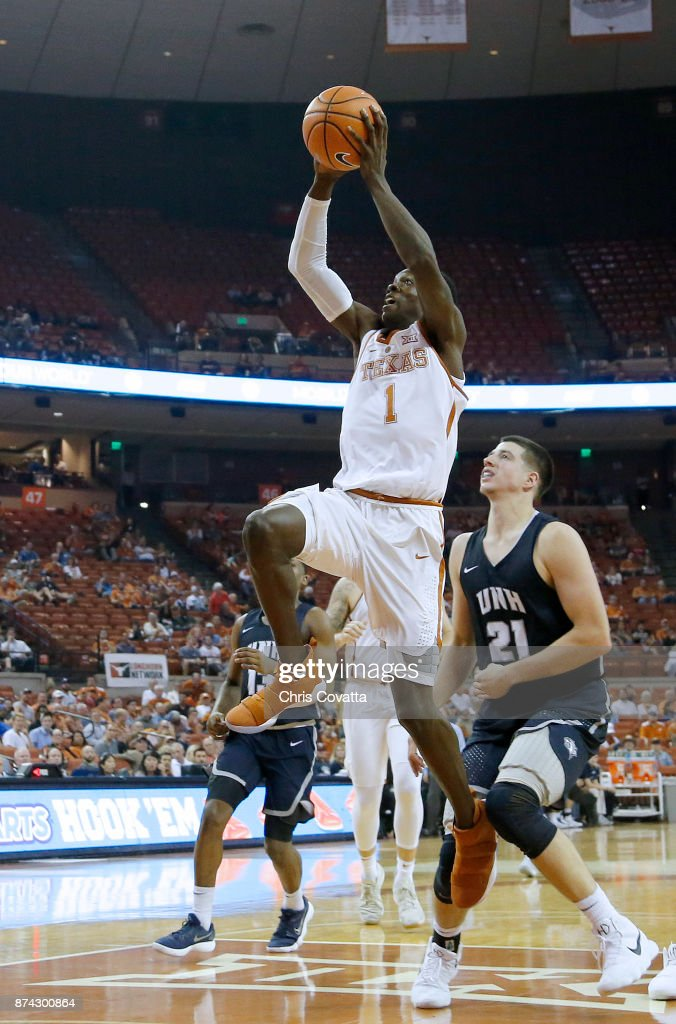Andrew Jones #1 of the Texas Longhorns leaps to the basket against Tanner Leissner #21 of the New Hampshire Wildcats at the Frank Erwin Center on November 14, 2017 in Austin, Texas.