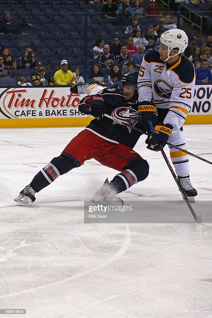 <a gi-track='captionPersonalityLinkClicked' href=/galleries/search?phrase=Andrew+Joudrey&family=editorial&specificpeople=696911 ng-click='$event.stopPropagation()'>Andrew Joudrey</a> #34 of the Columbus Blue Jackets checks <a gi-track='captionPersonalityLinkClicked' href=/galleries/search?phrase=Mikhail+Grigorenko&family=editorial&specificpeople=8771251 ng-click='$event.stopPropagation()'>Mikhail Grigorenko</a> #25 of the Buffalo Sabres during the third period on September, 2013 at Nationwide Arena in Columbus, Ohio. Buffalo defeated Columbus 3-1.