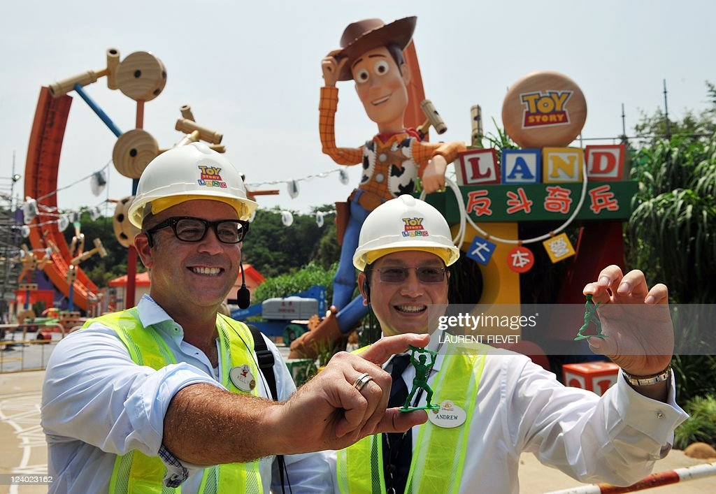Andrew Kam (R), managing director of Hong Kong Disneyland, and Kelly Willis (L), creative director for Hong Kong Toy Story Land, hold toy soldiers in front of Toy Story Land attraction site during its launch in Hong Kong September 8, 2011. Hong Kong Disneyland, which has been struggling to attract visitors, said its Shanghai counterpart was not a threat as it prepares for the opening of a new attraction this year. The Toy Story Land, which is based on the popular animated film, is due to open in November.