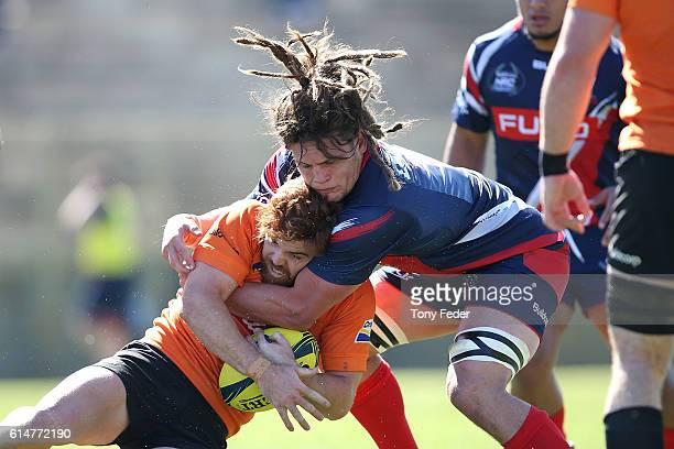 Andrew Kellaway of the Country Eagles is tackled by Reid Jordan of Melbourne Rising during the NRC Semi Final match between the NSW Country Eagles...