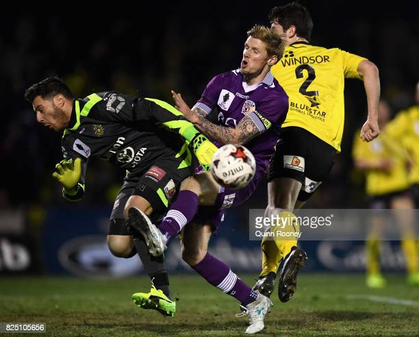 Andrew Keogh of Glory tries to get a shot past United keeper Christopher TheodoridisPetropoulos during the FFA Cup round of 32 match between...